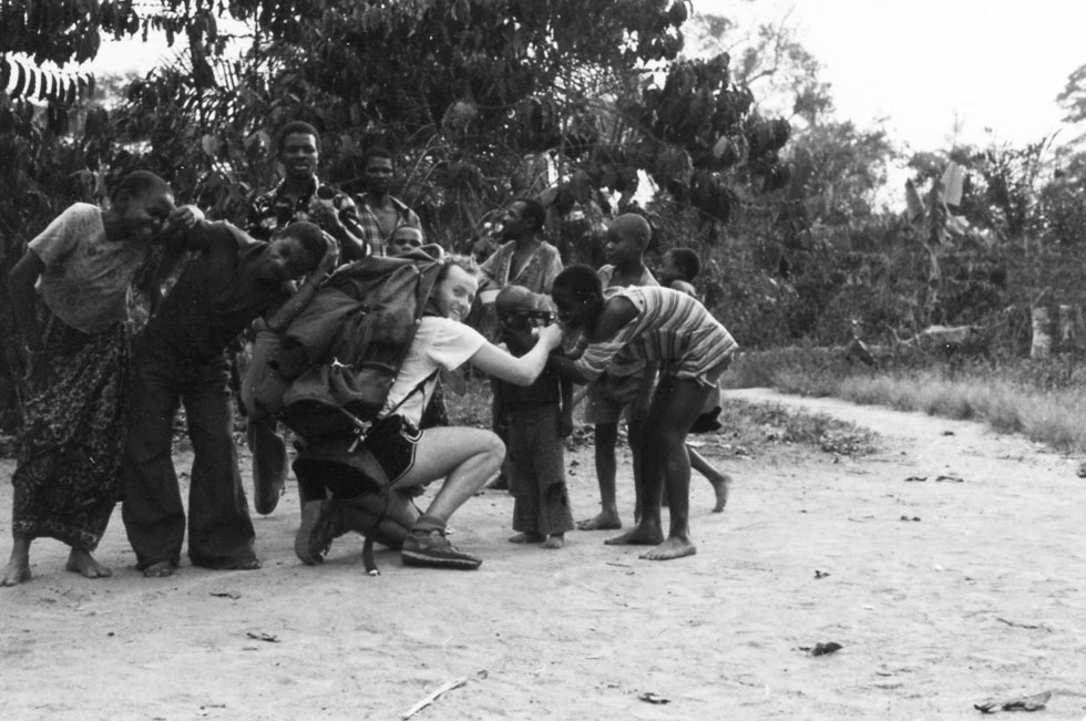 Children inspecting Moose Bond's camera - Bukavu, Zaire 1983