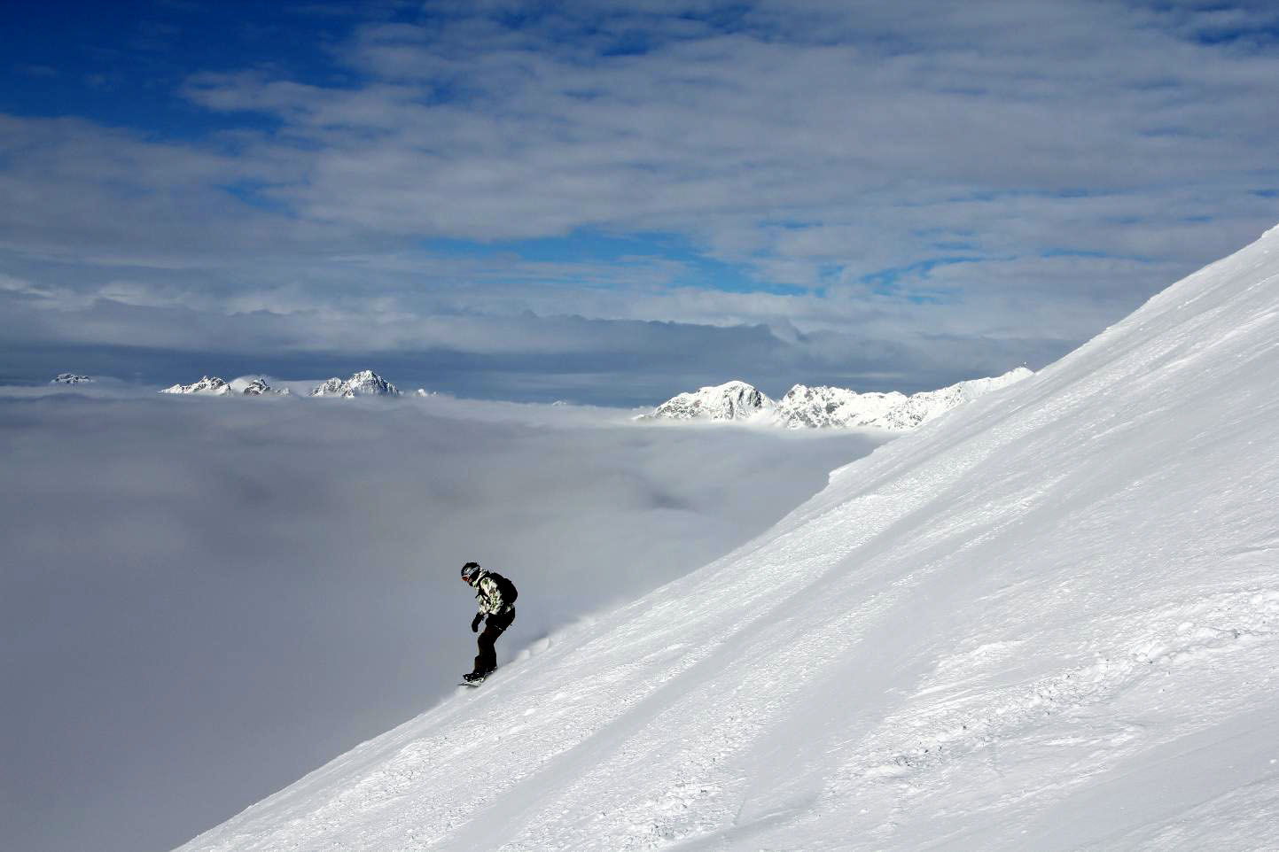 Snowboarding above the clouds © JonoVernon-Powell